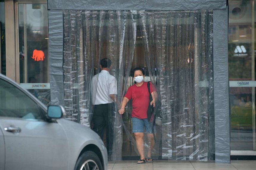 Plastic curtains called the haze vestibule drapped across the entrance of Bishan Junction 8 mall to minimise the haze from entering the mall.