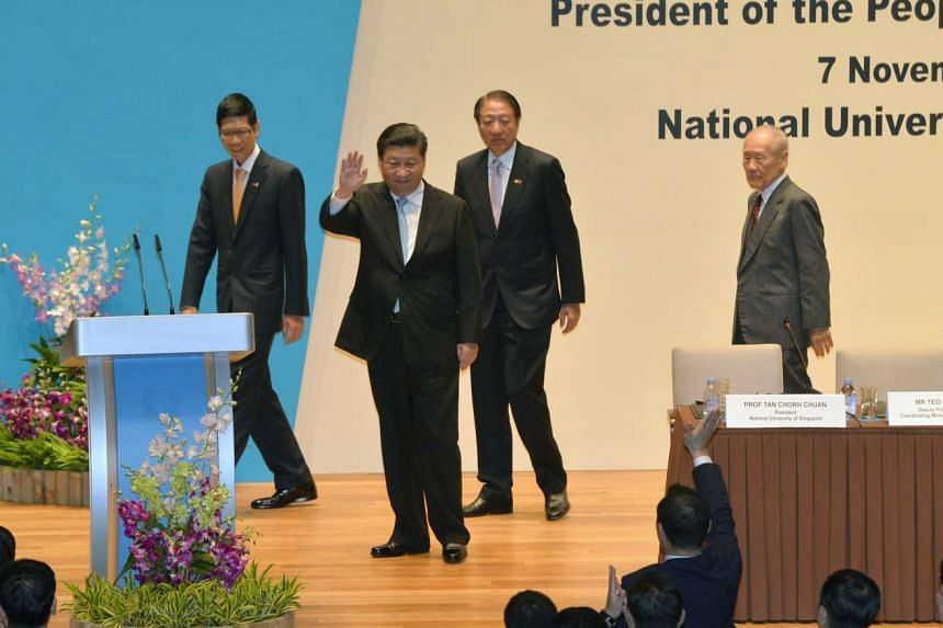 Mr Xi waving to the audience after delivering his lecture.
