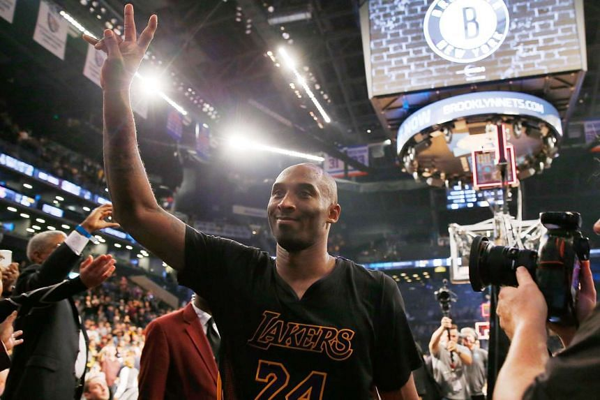 Kobe Bryant (24) of the Los Angeles Lakers waves to the crowd after defeating the Brooklyn Nets.