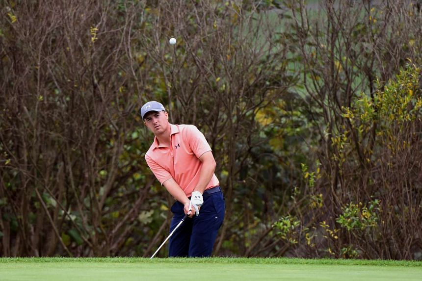 Jordan Spieth of the US chips on to the green during the third round of the WGC-HSBC Champions golf tournament in Shanghai on Nov 7, 2015.