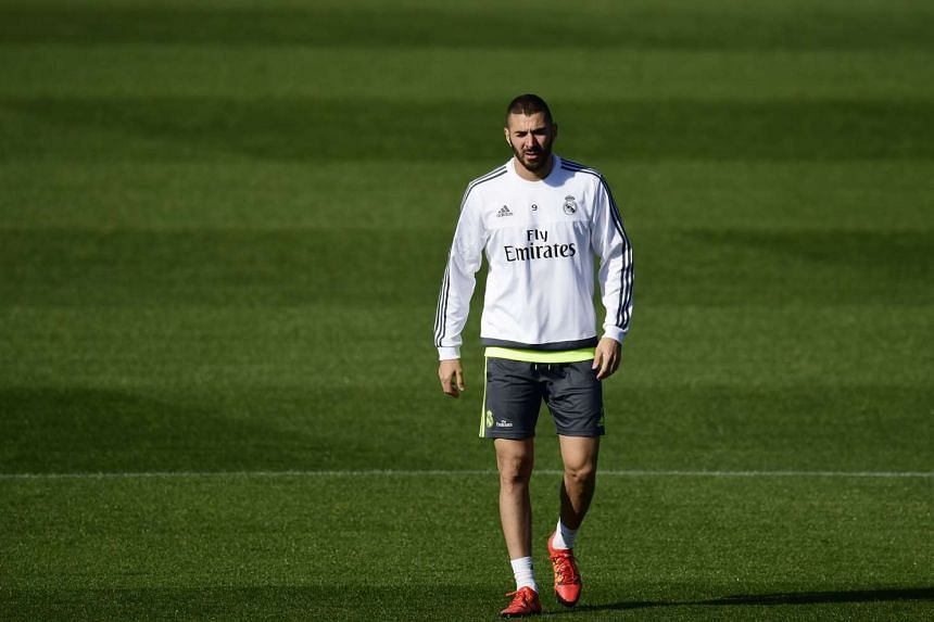 Karim Benzema has been left out of coach Rafael Benitez's squad for Real Madrid's trip to Sevilla on Sunday.