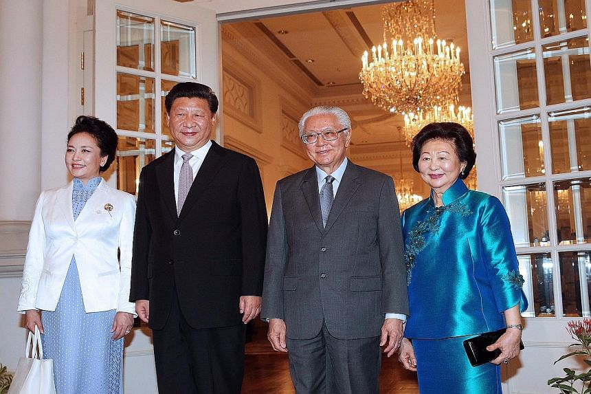 (From far left) Madam Peng Liyuan, Chinese President Xi Jinping, President Tony Tan Keng Yam and Mrs Mary Tan at the Istana yesterday. Mr Xi arrived yesterday for a two-day state visit to mark 25 years of diplomatic relations between China and Singap