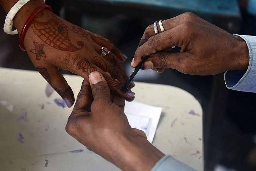A woman in the village of Thakurganj in Bihar getting an ink mark on her finger to indicate that she has voted. Mr Modi was the face of the BJP's election campaign in Bihar and addressed more than 25 rallies.
