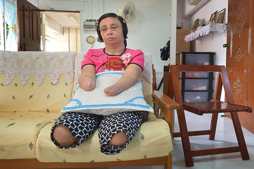 Ms Sarina Kaur at home in Holland Close (above). Her legs were cut off in December 2012, and the next month, she lost her hands and lower right forearm.