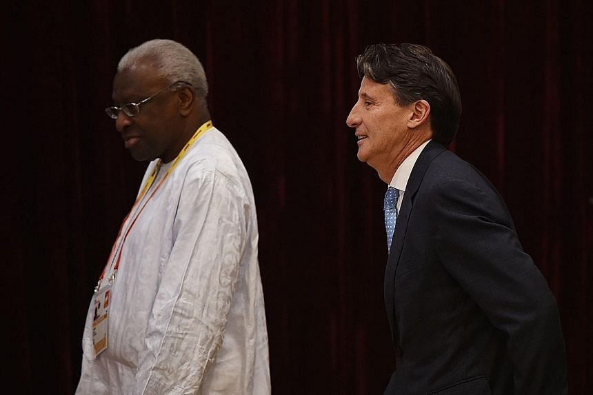 Outgoing IAAF president Lamine Diack with newly elected chief Sebastian Coe at the Beijing congress in August. The 82-year-old Senegalese, out on bail, is suspected of accepting bribes to cover up positive Russian dope tests.