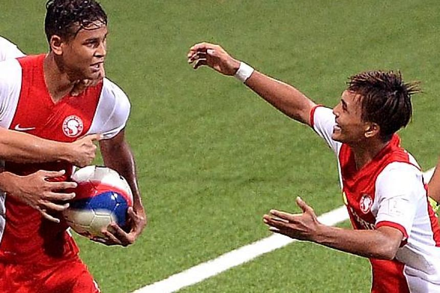 Taufik Suparno (right) celebrating with fellow striker Irfan Fandi after the latter's late equaliser against Harimau Muda last month. He won the Prime League with Tampines and has played five S-League games.