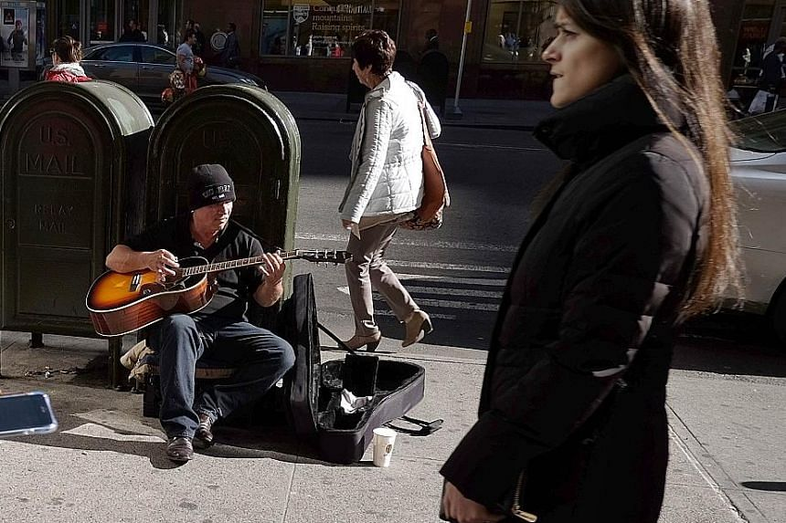 A busker performing on a New York street. Non-farm payrolls increased by 271,000 last month, exceeding all estimates in a Bloomberg survey of economists. The median forecast was for a 185,000 advance.