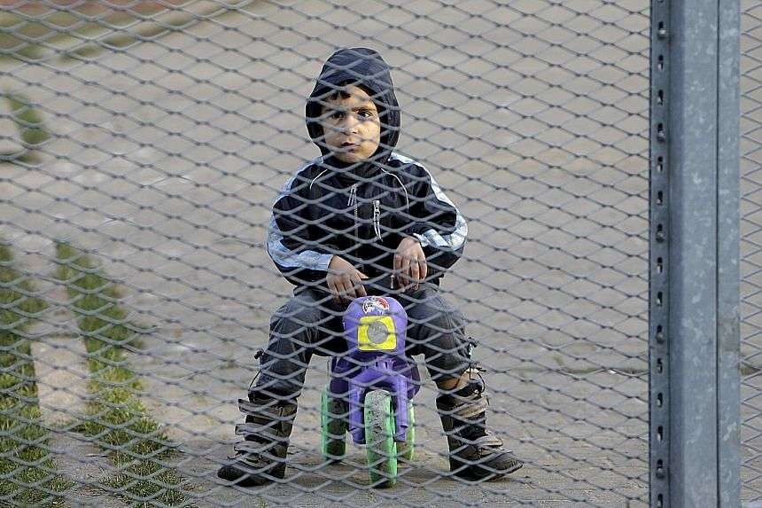 A migrant child in a foreigner detention facility in the Czech Republic. The UN estimates that there are three million stateless children globally and 70,000 are born annually. In some countries, they are not entitled to government-run immunisation p