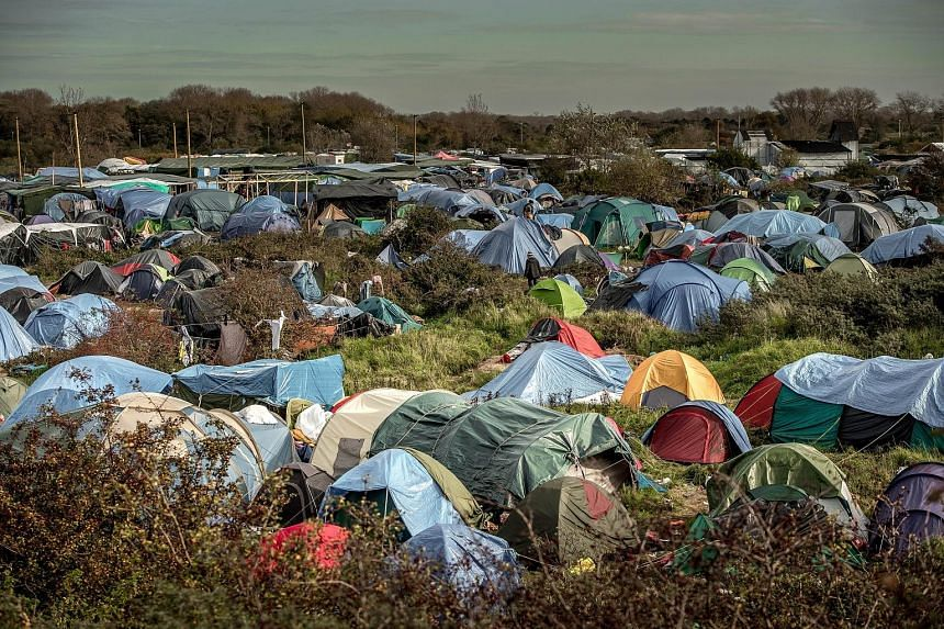 A migrant camp in Calais, France. In a forecast, EU officials predicted that the three million migrants expected over the next three years would provide a small net gain to the European economy by 2017.