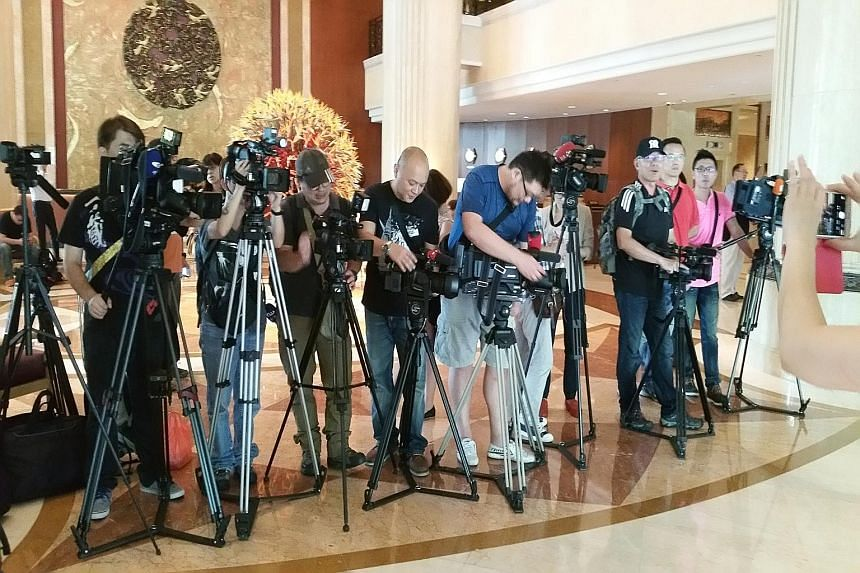Cameramen and reporters taking their positions at the lobby of Shangri-La Hotel yesterday. Foreign media outlets have flown teams here to cover the meeting between Taiwanese President Ma Ying-jeou and Chinese President Xi Jinping.