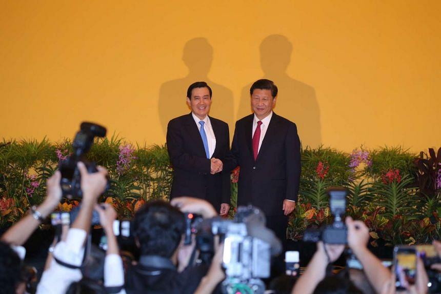 China's President Xi Jinping shakes hands with Taiwan's President Ma Ying-jeou. -- ST PHOTO: NEO XIAOBIN