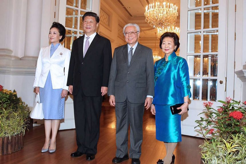 China's President Xi Jinping (second from left) and his wife Peng Liyuan (left) calling on President Tony Tan Keng Yam (second from right) and Mrs Mary Tan at the Istana on Nov 6.