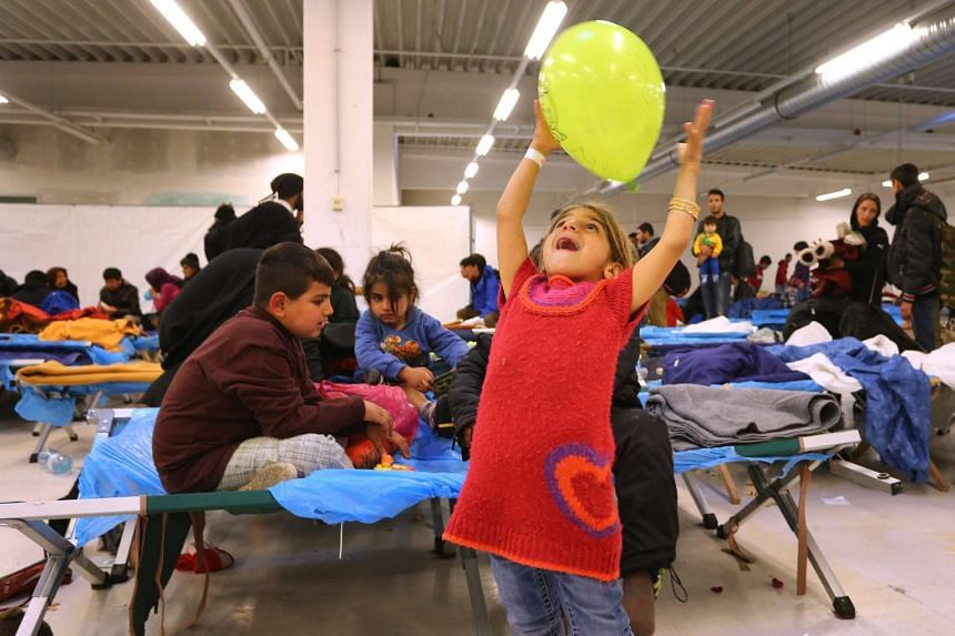 A refugee girl from Iraq at a centre in Freilassing, Germany.