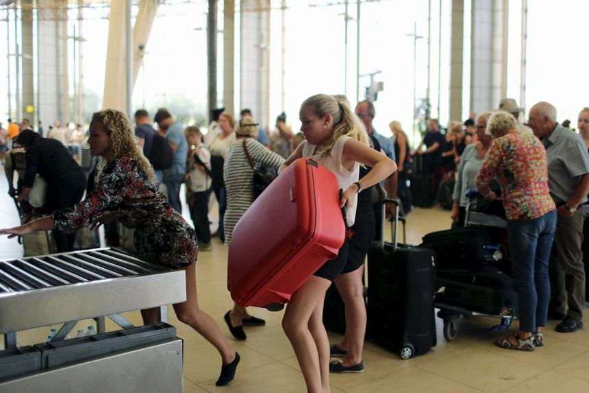 Tourists heading home at Sharm el-Sheikh aiport after their holidays.