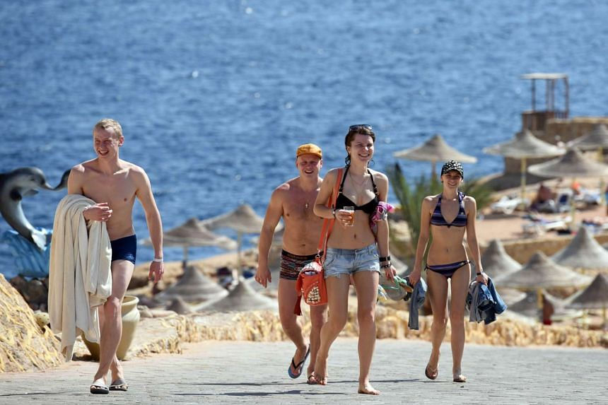 Tourists come back from the beach in the Egyptian resort of Sharm el-Sheikh on Nov 7, 2015.