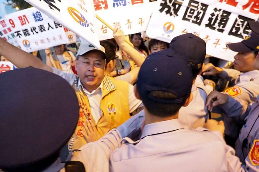 Members of the Taiwan Solidarity Union protesting the upcoming meeting between Taiwanese President Ma Ying-jeou and Chinese President Xi Jinping outide the Taipei Songshan Airport on Nov 7, 2015.