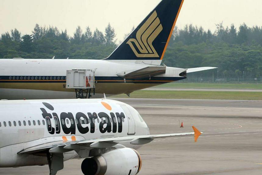 Tigerair and SIA planes at Changi Airport.