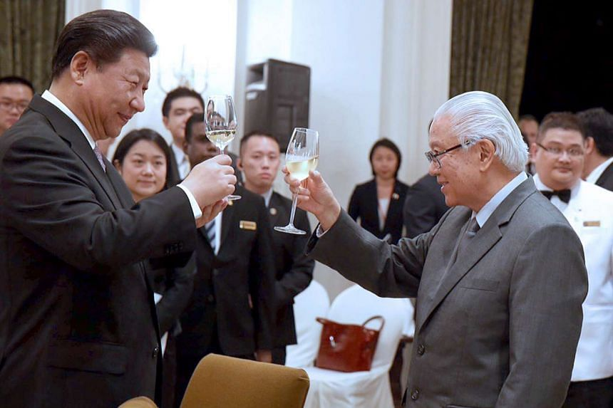 President Tony Tan Keng Yam toasting Chinese President Xi Jinping at a state banquet held in honour of the Chinese leader at the Istana yesterday. Speaking at the banquet, Dr Tan said both countries have agreed to launch a substantive upgrade of the