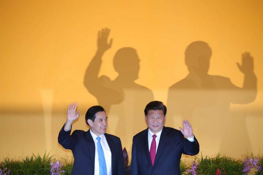 China's Xi Jinping and Taiwan's Ma Ying-jeou wave after shaking hands at their historic meet in Singapore.