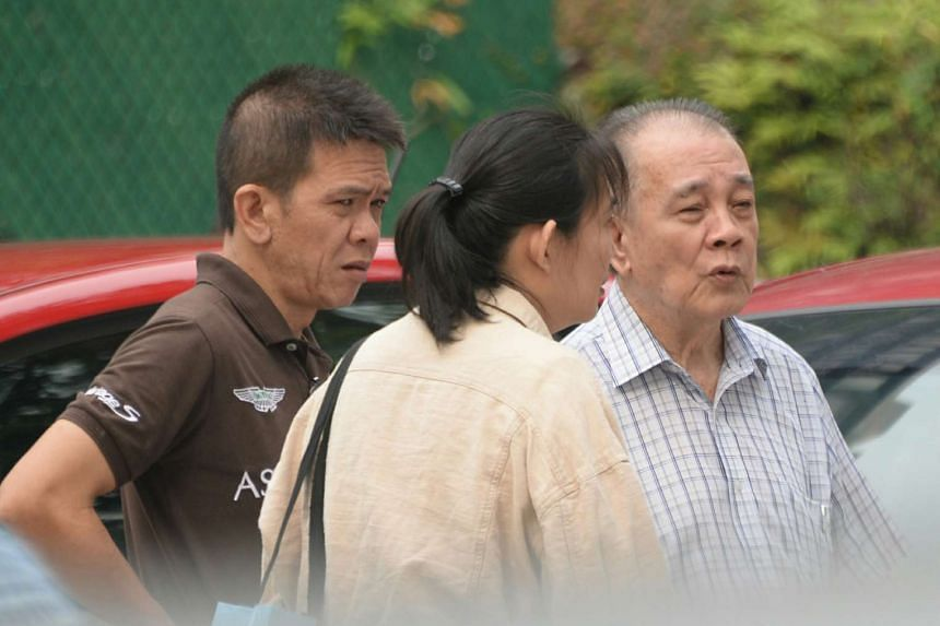 Student Luke Chan's father (left), mother (centre) and grandfather outside the morgue on Nov 8, 2015.