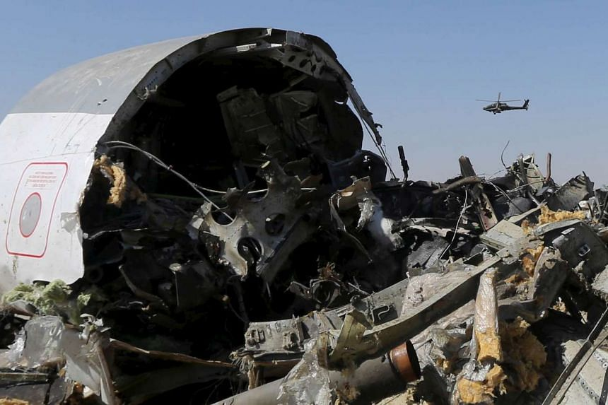 An Egyptian military helicopter flies over debris from the crashed Russian airplane in Egypt's Sinai peninsula, on Nov 1, 2015.