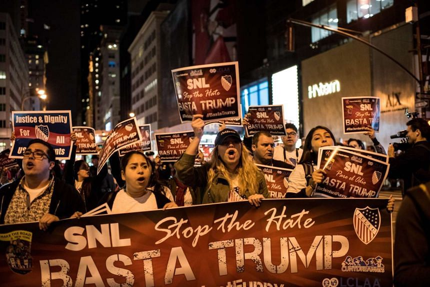 Members of Latino organisations march to NBC studios to protest Donald Trump's appearance on Saturday Night Live.