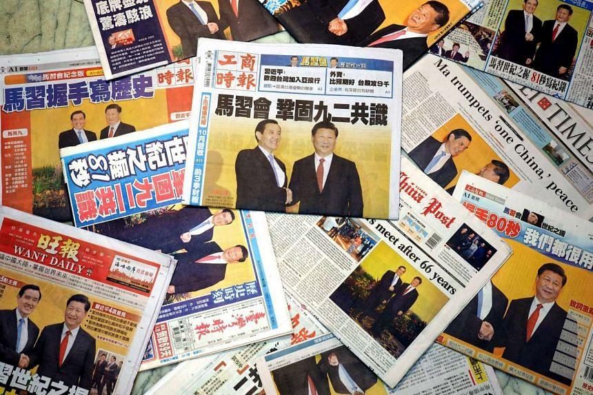 Taiwanese newspaper front-pages are dominated by reports and photos of the the meeting between Chinese President Xi Jinping and Taiwan's President Ma Ying-jeou in Singapore the previous day, in Taipei, on Nov 8, 2015.