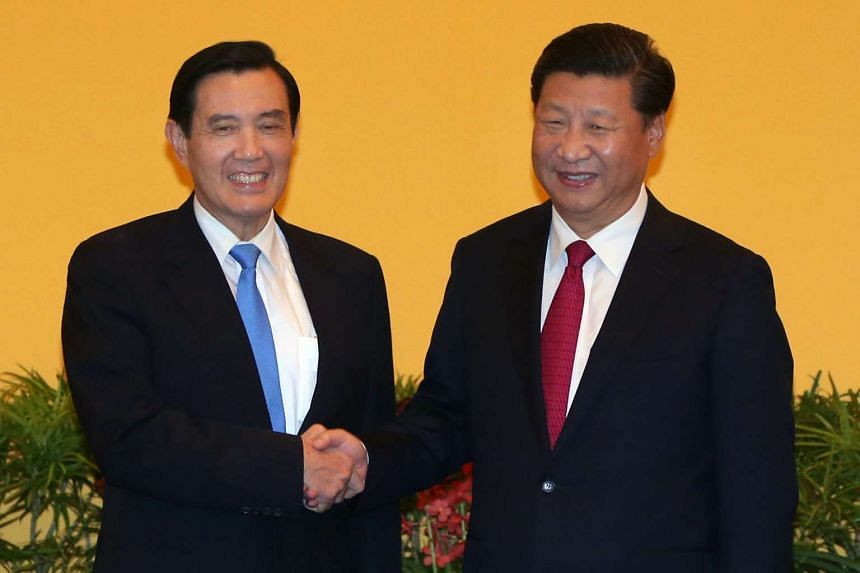 Chinese President Xi Jingping (right) and Taiwanese President Ma Ying-jeou shaking hands at the Shangri-La Hotel in Singapore on Nov 7, 2015.