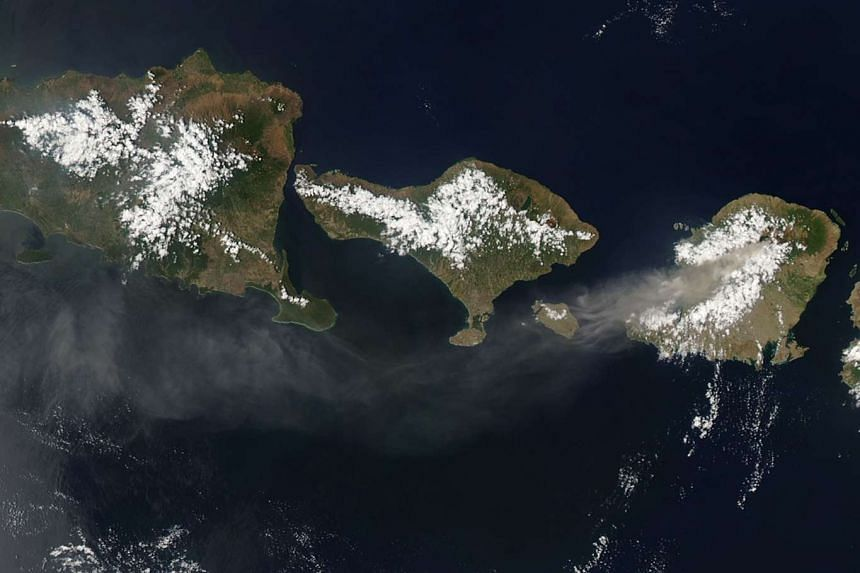 A Nasa Earth Observatory image showing smoke and ash from Mt Rinjani (left) spreading out over Bali and Java, on Nov 7, 2015. P
