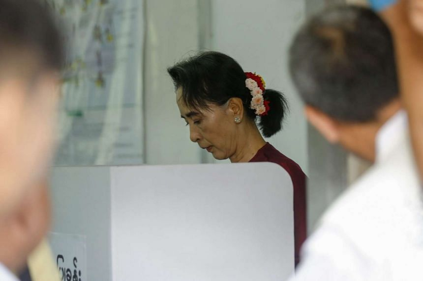 Myanmar opposition leader Aung San Suu Kyi casting her vote at a polling station in Bahan township, Yangon, on Nov 8, 2015.