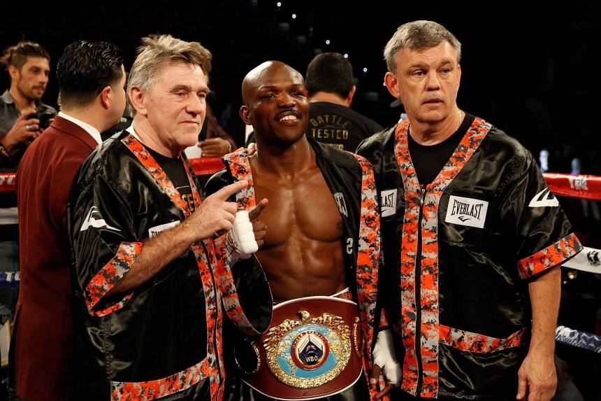 Timothy Bradley (centre) poses after defeating Brandon Rios in a title fight on Nov 7, 2015 in Las Vegas, Nevada.