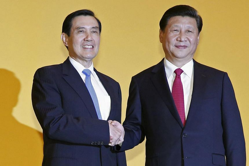 Chinese President Xi Jinping shakes hands with Taiwan's President Ma Ying-jeou during a summit in Singapore Nov 7, 2015.