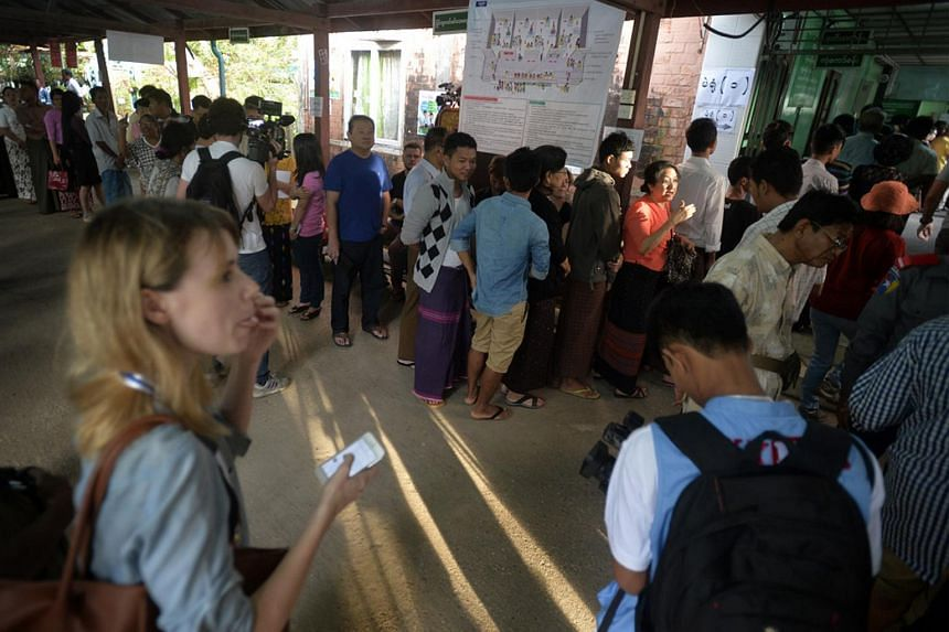 Myanmar citizens line up to vote at a polling station in a primary school in Bahan Township, Yangon, on Nov 8, 2015.