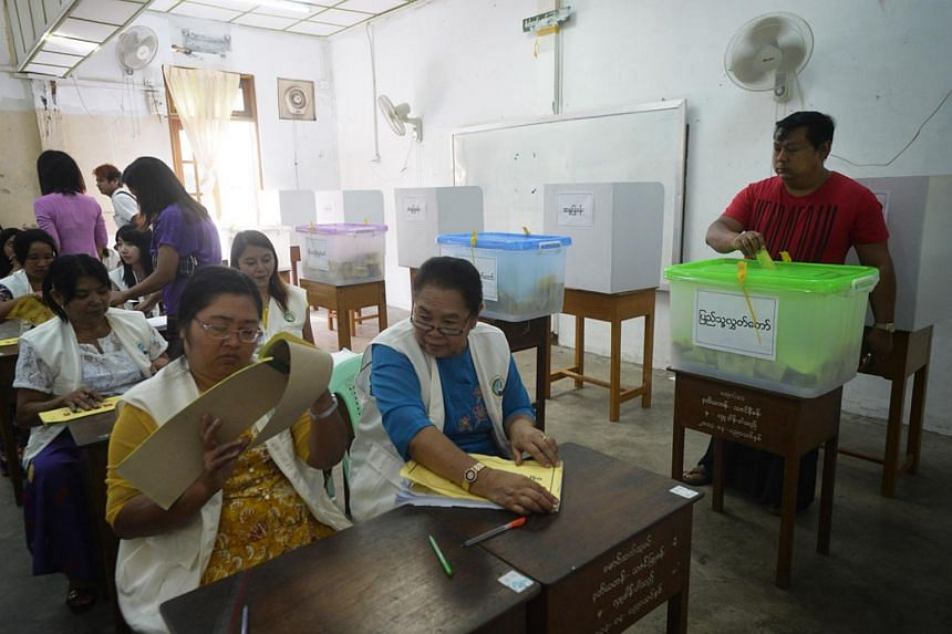 A Myanmar man casts his vote at a polling station in a primary school in Bahan Township, Yangon, on Nov 8, 2015.