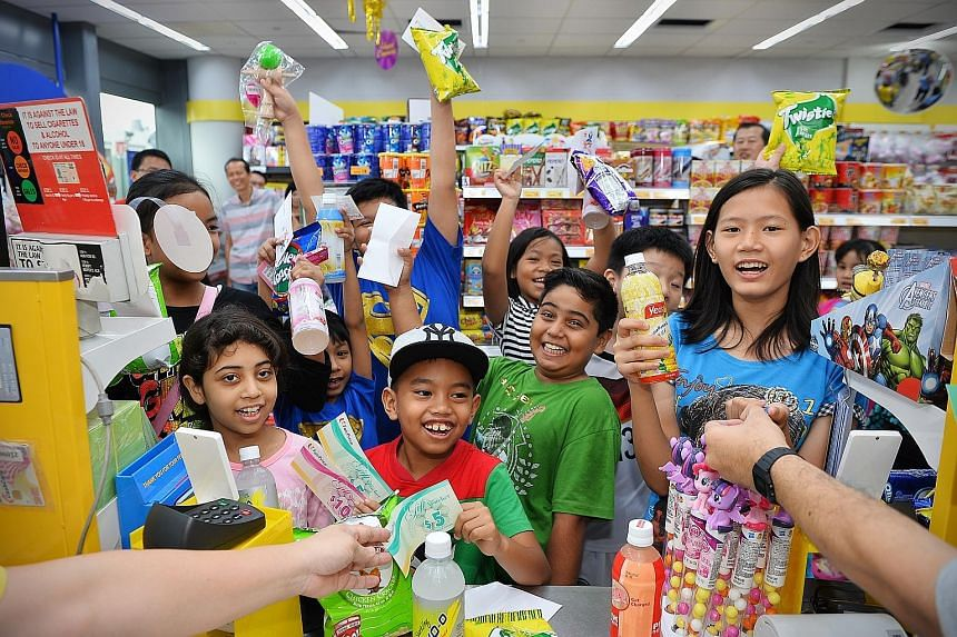 Twenty children helped by The Straits Times School Pocket Money Fund enjoyed a sponsored shopping trip to a Cheers outlet at Kallang Wave Mall yesterday, where they were given $15 each in vouchers to purchase food and drinks. The event marked the clo