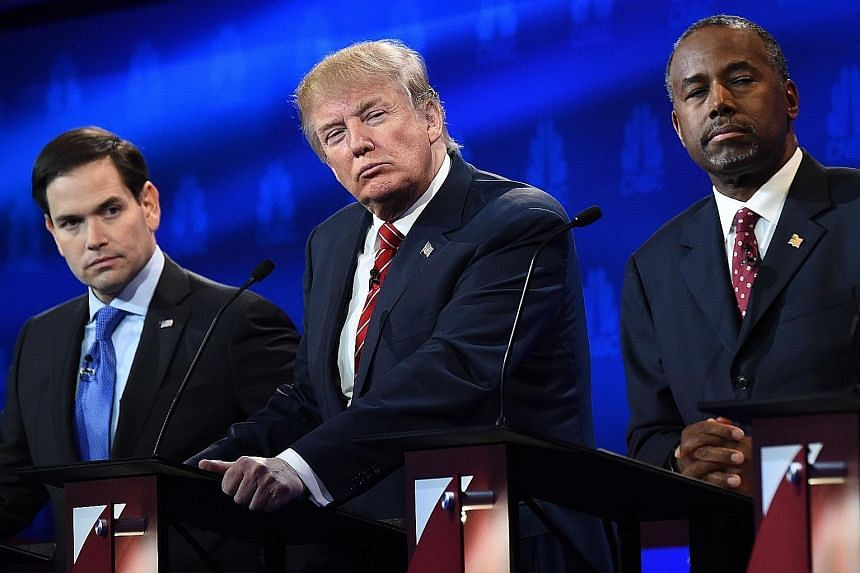 Presidential hopefuls (from left) Marco Rubio, Donald Trump and Ben Carson during the CNBC Republican Presidential Debate in Boulder last month. A poll of polls shows Dr Carson in the lead.
