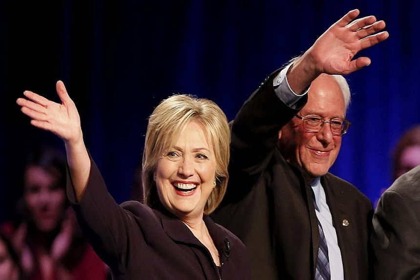 Democratic presidential candidates Hillary Clinton and Bernie Sanders at a forum in South Carolina on Friday. According to the RealClearPolitics website, Ms Clinton has the support of 54.8 per cent of Democratic voters while Mr Sanders is backed by 3