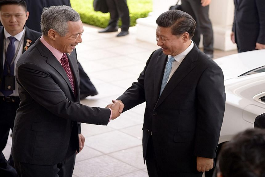 PM Lee Hsien Loong (left) receiving Chinese President Xi Jinping at the Istana. In a Facebook post, Mr Lee said he had a fruitful meeting with Mr Xi, whose two-day state visit further deepened the bilateral relationship.
