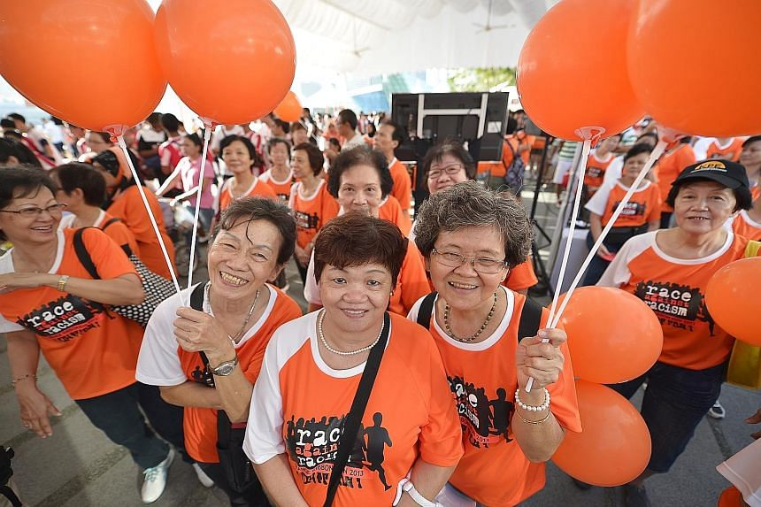 About 5,000 people took part in the first Orange Ribbon Run, themed the Race Against Racism, in 2013. It was organised by OnePeople.sg, a body that promotes racial harmony. Chinese New Year is a neighbourly affair (above) for these Sembawang resident