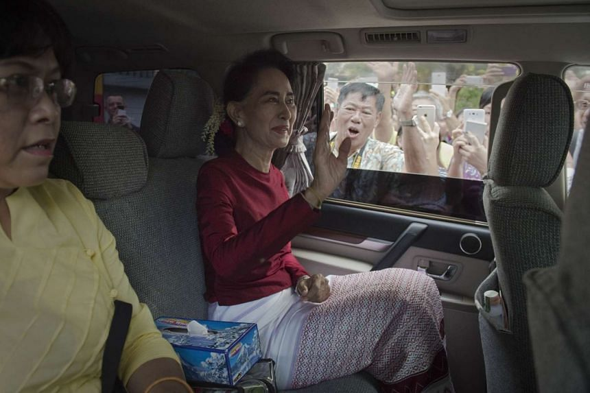 Aung San Suu Kyi leaves her house to cast her vote at a polling station in Yangon on Nov 8, 2015.