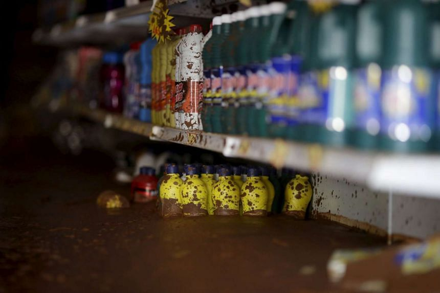 Cleaning products are pictured at a market flooded with mud after a dam, owned by Vale SA and BHP Billiton Ltd burst, in Barra Longa, Brazil, Nov 7, 2015.