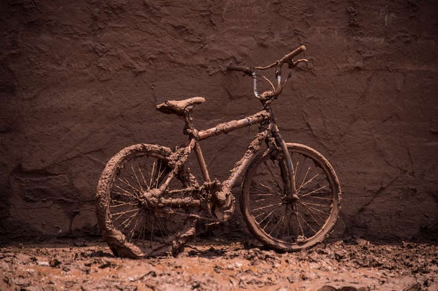 A bicycle covered by mud parked in a street of Barra Longo city, Brazil on Nov 7, 2015.