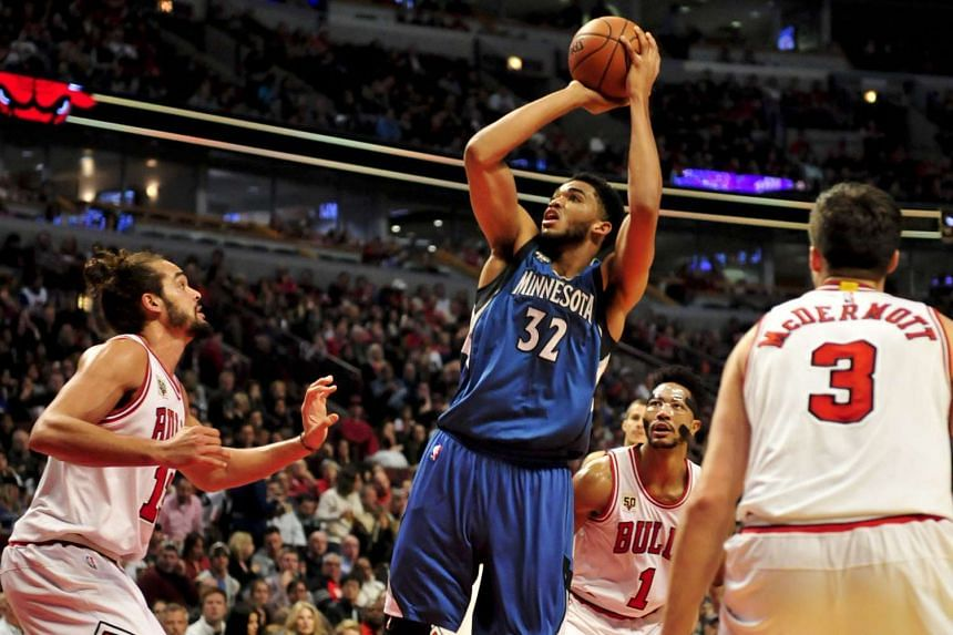 Minnesota Timberwolves centre Karl-Anthony Towns (#32) shooting over Chicago Bulls centre Joakim Noah (left) during the NBA game at the United Centre on Nov 7, 2015.