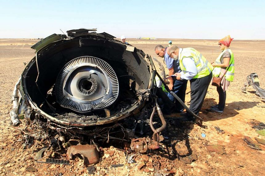 Egyptian investigators check debris from the crashed Russian jet.