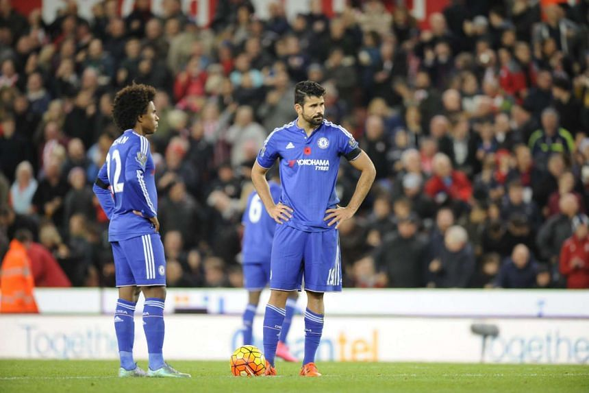 Chelsea's Diego Costa (right) and Willian react after Stoke took a 1-0 lead.