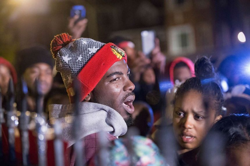 Pierre Stokes, the father of nine-year-old Tyshawn Lee, speaks to supporters during a candlelight vigil.