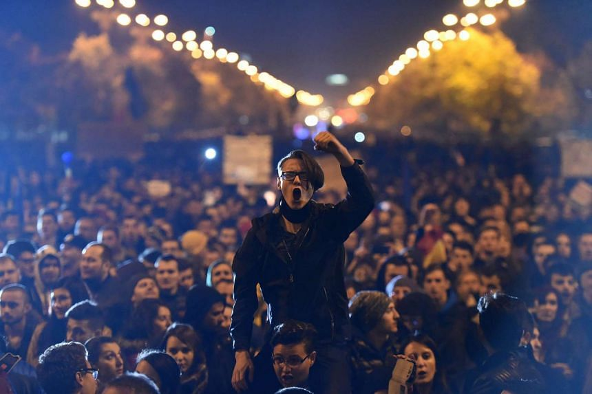 Romanians stage a political protest, triggered by the nightclub blaze, in Bucharest on Nov 4, 2015.