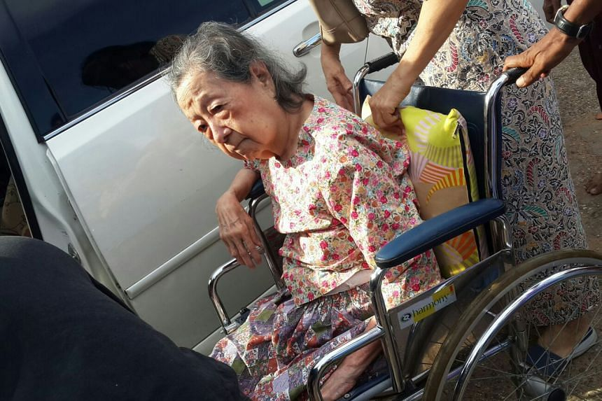 92-year-old Daw Myint Myint, who was lifted out of her car and placed on a wheelchair, and carried up the staircase to vote at  the Sri Thiri Mingalar Mahar Dhammaryone Monastery.