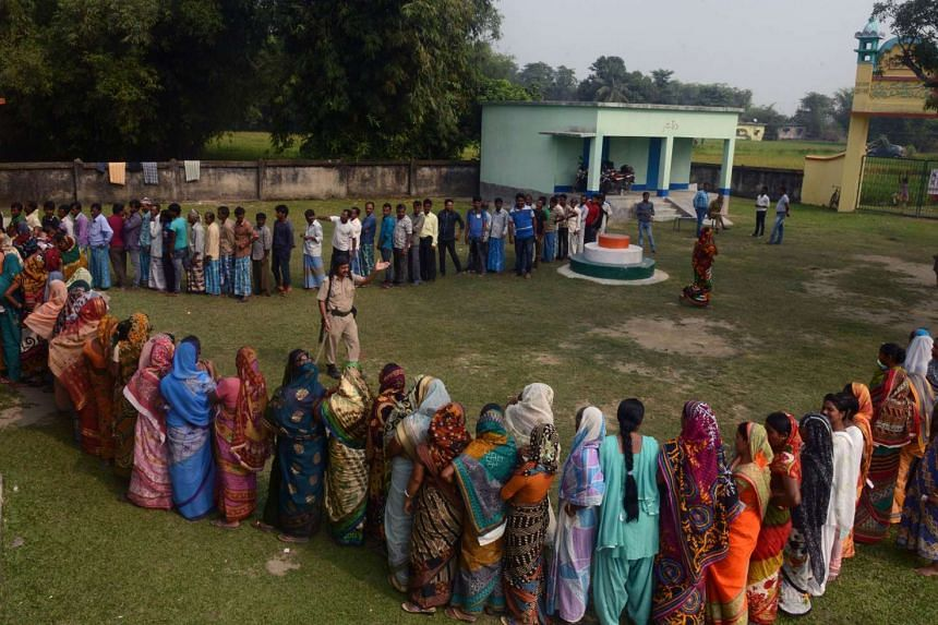 Indian voters queue to cast their ballots at a voting centre in the final stage of state assembly elections in the Bihar village of Thakurganj in Kishanganj district on Nov 5, 2015.