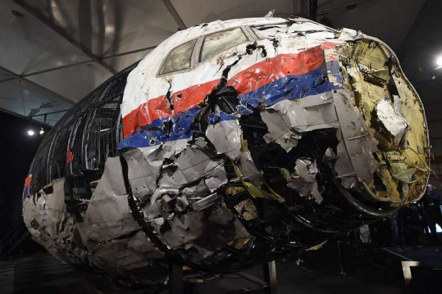 The wrecked cockipt of the Malaysia Airlines flight MH17 is presented to the press in October 2015.